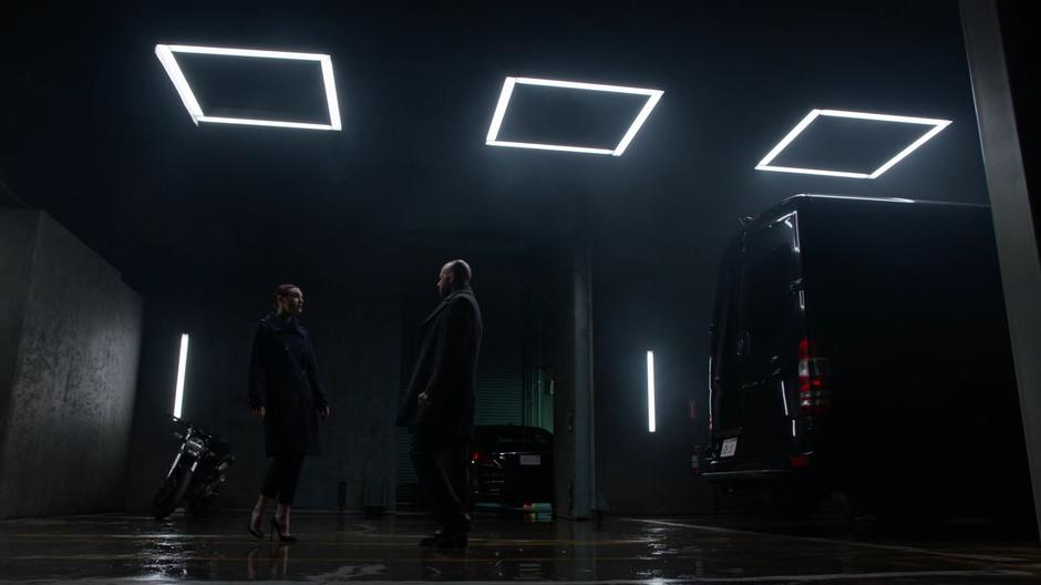 Lena approaches Lex as he exits his van to confront him about missing their meeting.