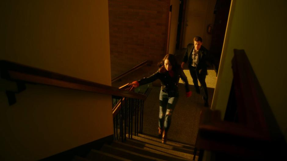 Sue and Ralph run out of John Loring's office towards the roof.