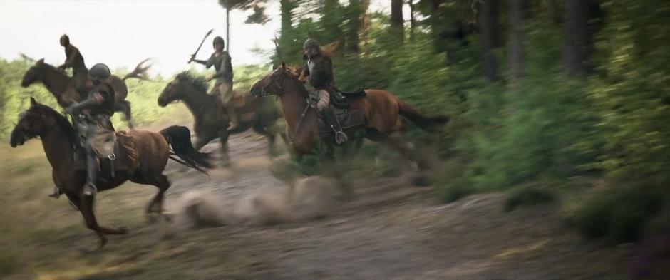 Soldiers burst out of the woods on horseback.
