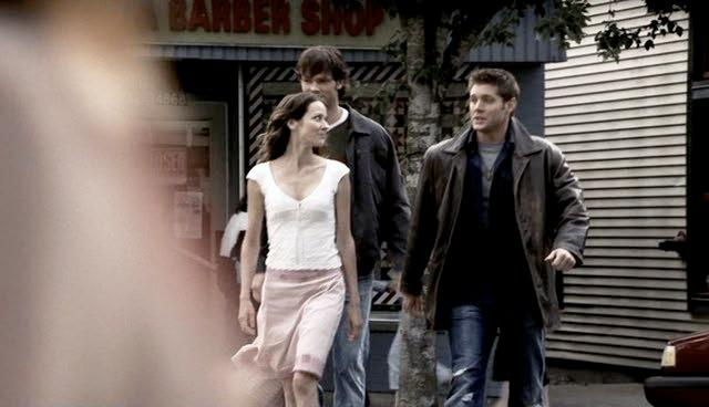 Andrea Barr leads Sam & Dean to their motel.