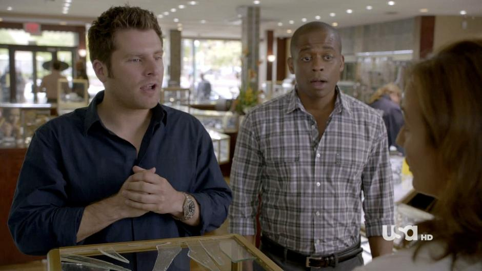 Shawn and Gus talk to the manager of the jewelry store.