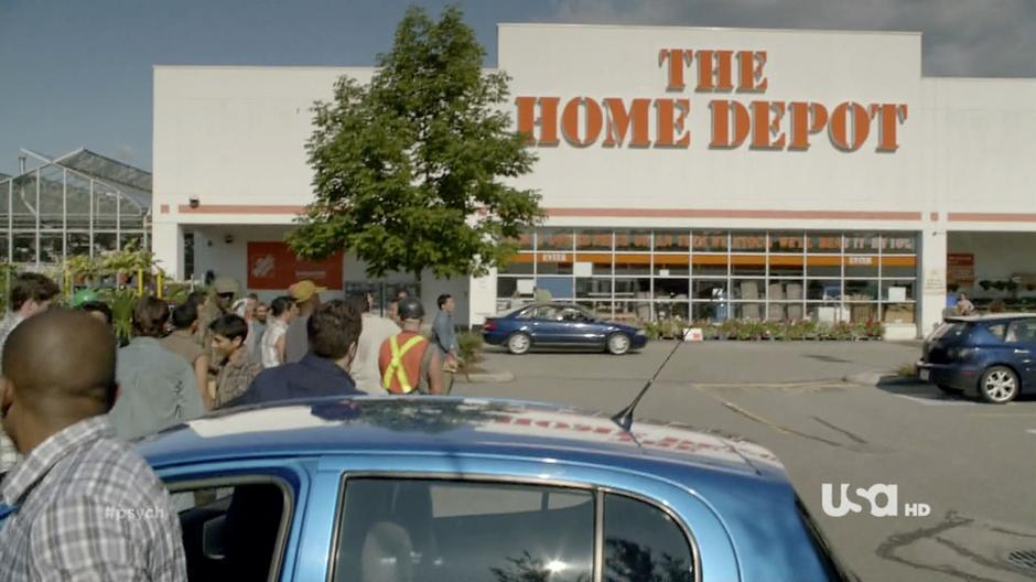Shawn and Gus get out of the Blueberry out front of The Home Depot.