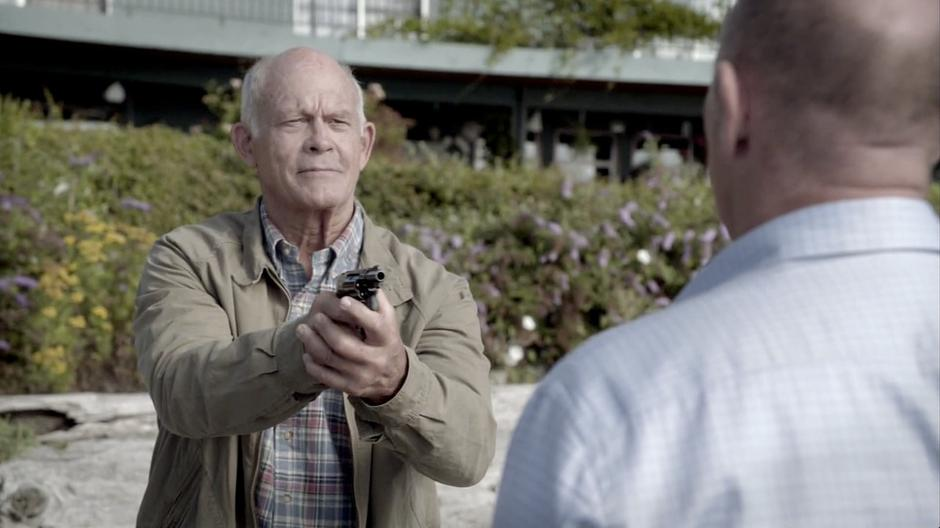 Jerry Carp points his gun at Henry after Henry realizes the truth.