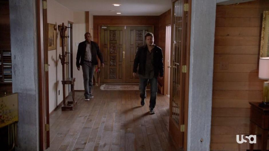 Shawn and Gus search through the house.