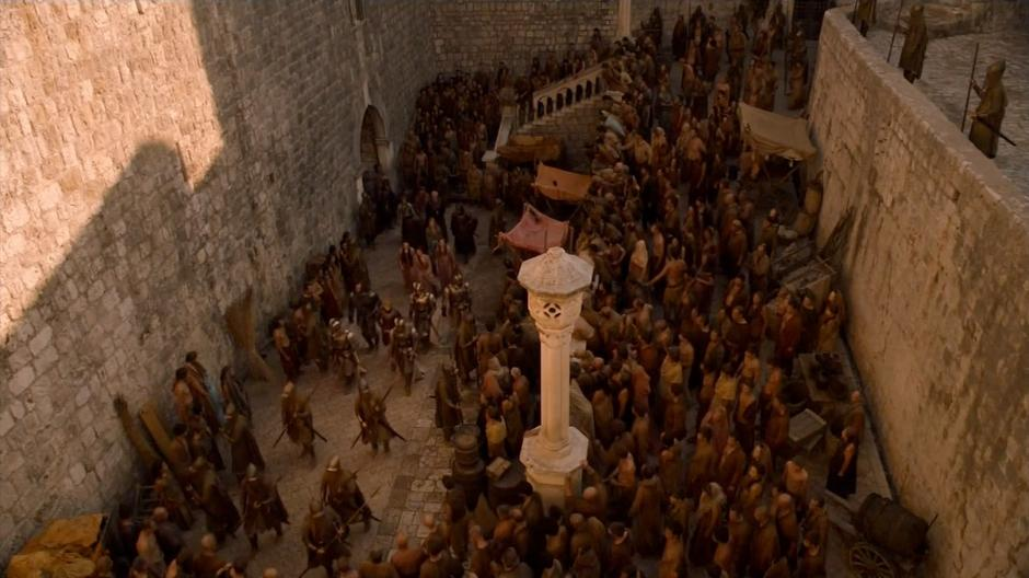 The Lannister group attempts to move through an angry crowd.