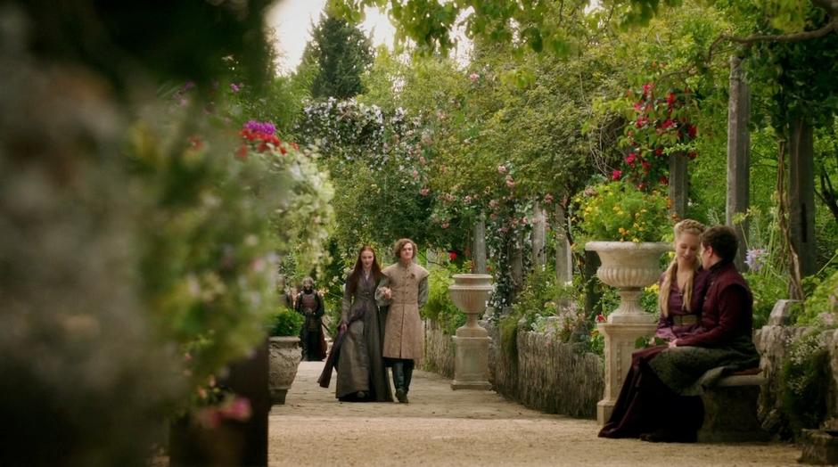 Lancel escorts Sansa through the gardens.
