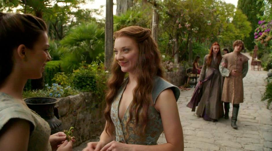 Sansa and Lancel approach Margaery who is talking with some girl.