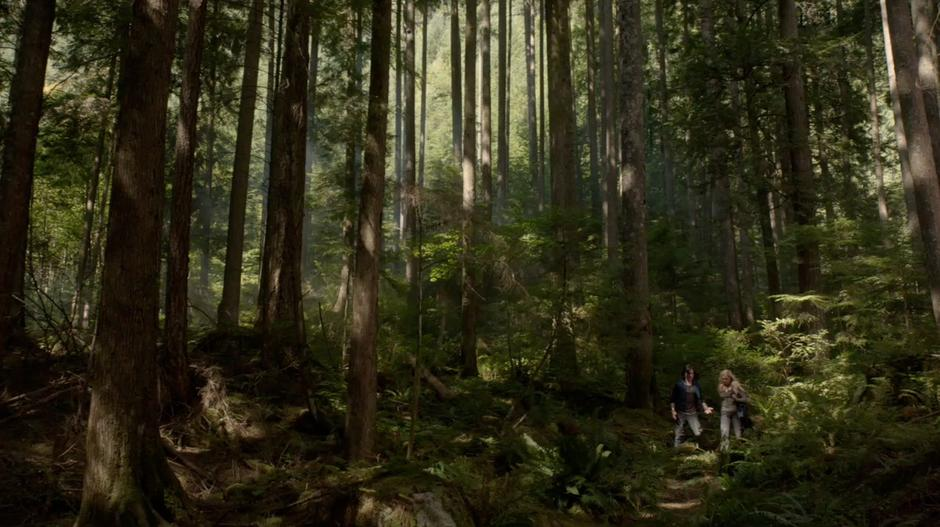 Clarke and Finn argue while walking through the woods.