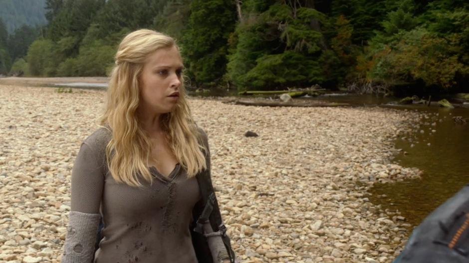 Clarke looks for the medicinal plants in the river.