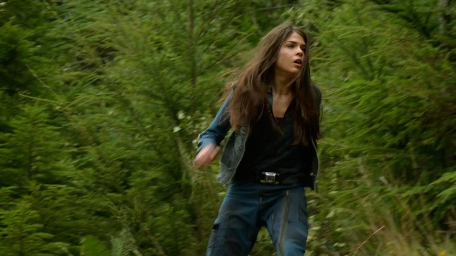 Octavia bursts from the trees while running from an unknown pursuer.