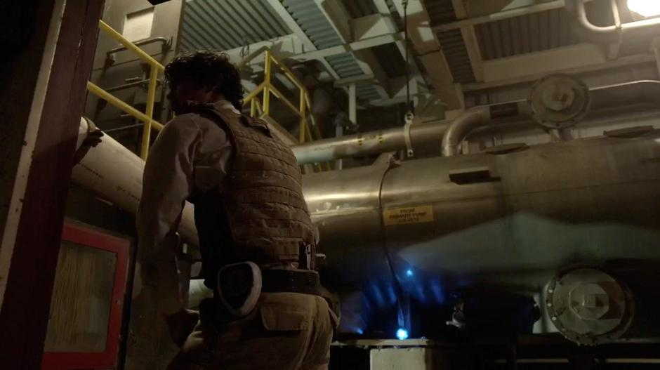 Bellamy pulls a fire ax from its place on the wall.