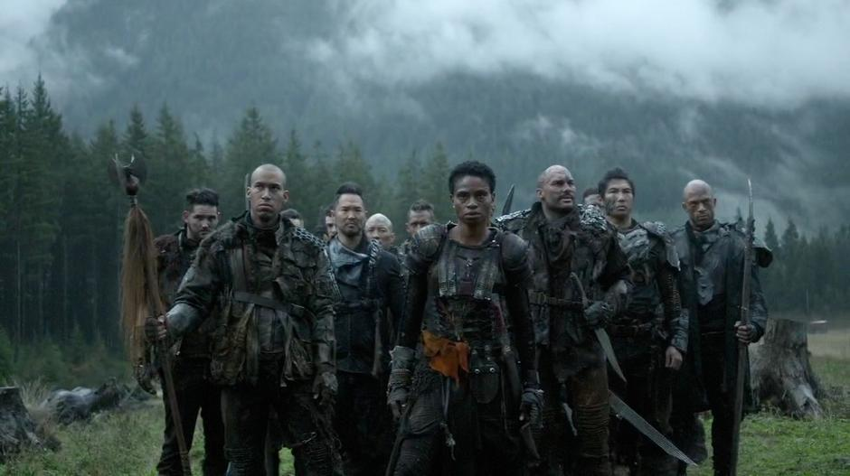 Indra leads a group of Grounder warriors into Camp Jaha.