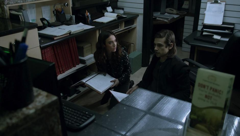 Julia & Quentin look through the records behind the reception desk for clues as to where Julia's shade was taken.