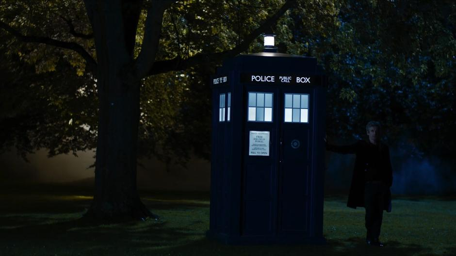 The Doctor stands outside with his Tardis and invites Bill to come along with him.