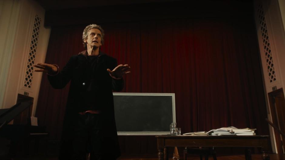 The Doctor gives an impassioned lecture from the stage.