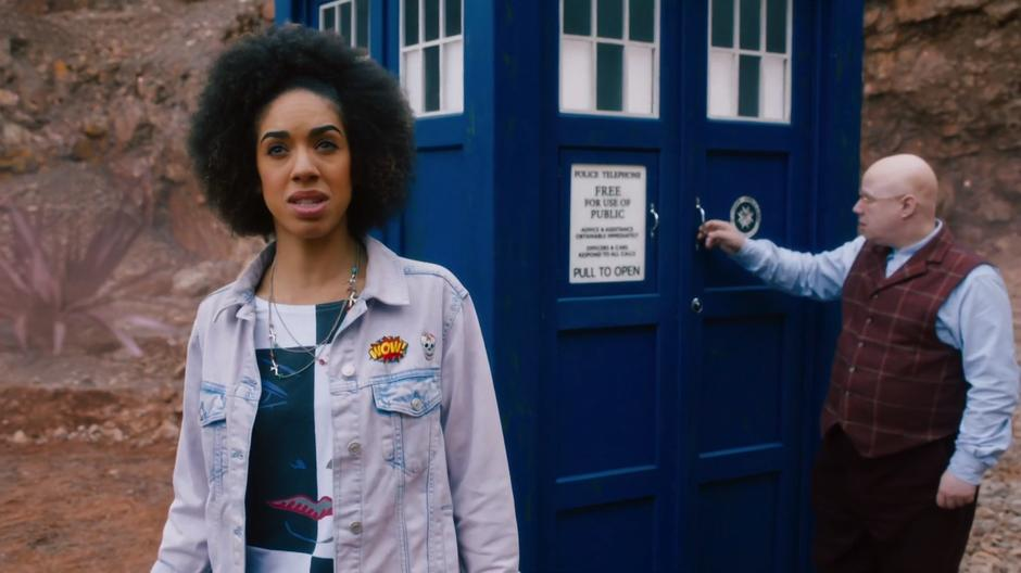 Bill looks around while Nardole closes up the Tardis behind her.