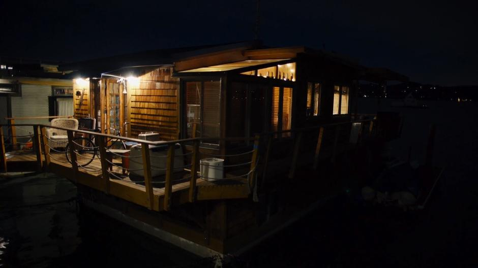 Bug's houseboat sits in the dark.