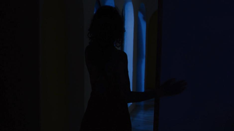 Kala walks out of her bedroom in the middle of the night.