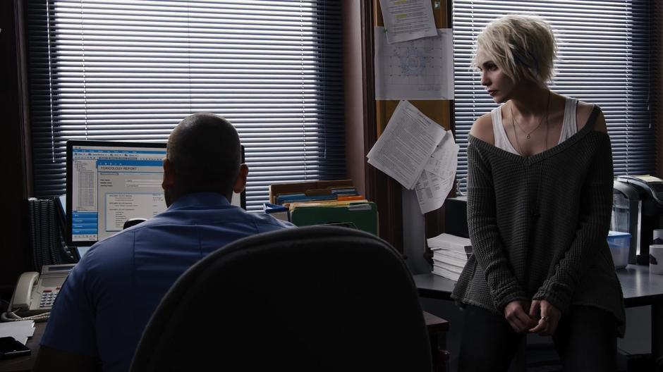 Riley looks at the screen while Diego reviews the toxicology report on Carol Cumberland.