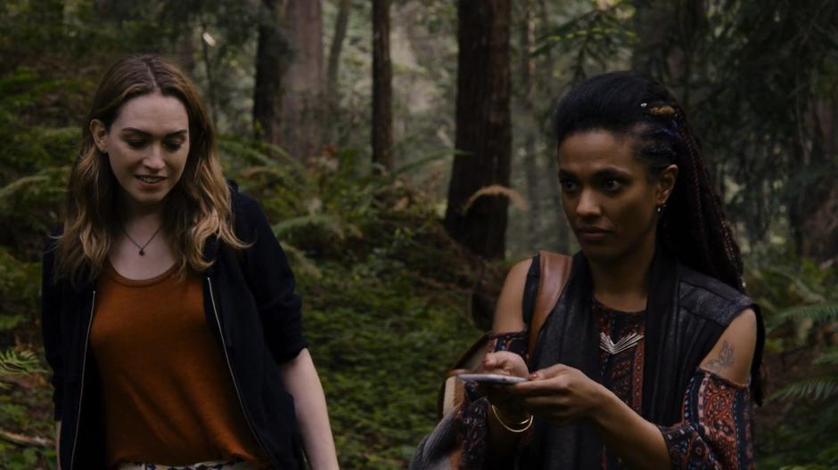 Nomi follows Amanita as she uses her phone's GPS to locate the cabin.