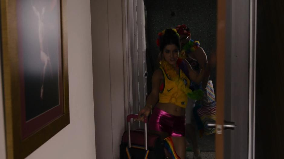 Dani dances back into the apartment followed by Hernando while dressed fancily after their trip.