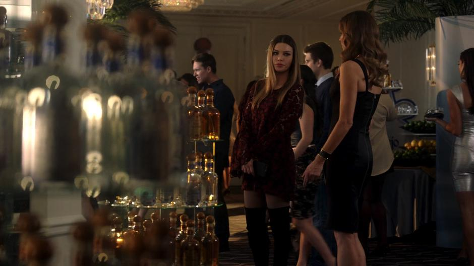 Chloe looks around the party with Charlotte while looking fine as hell.