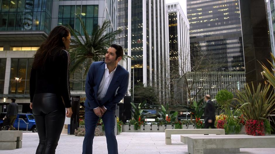 Lucifer tries to talk to Maze about why she is mad in the plaza outside the offices.