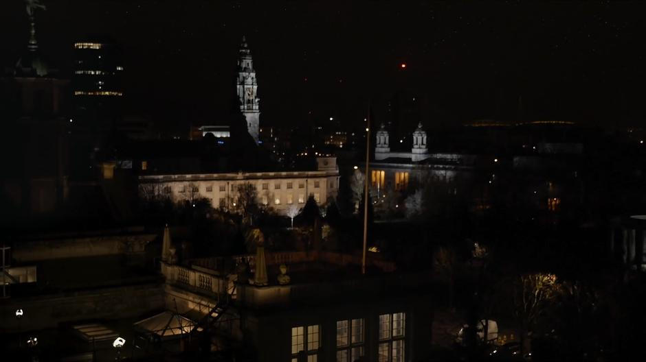 Wide shot of Bill and the Doctor sitting on the roof of the university at night.