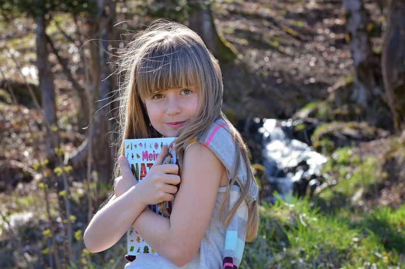 possessive girl holding book