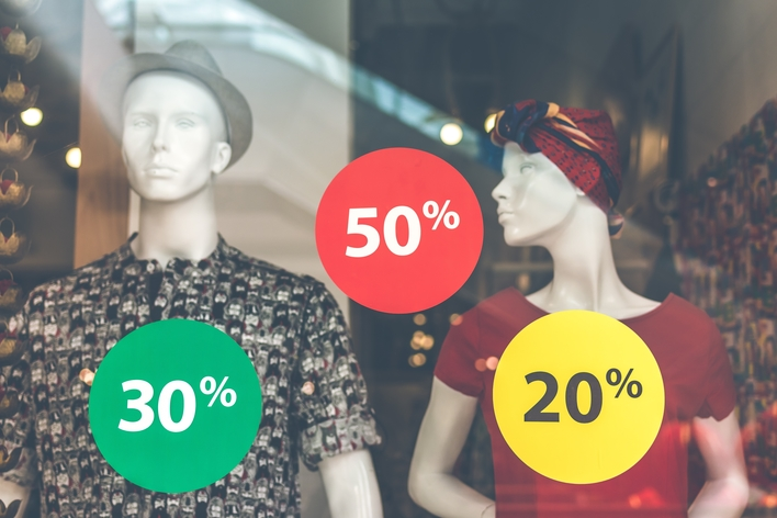 Clothed mannequins and round discount signs