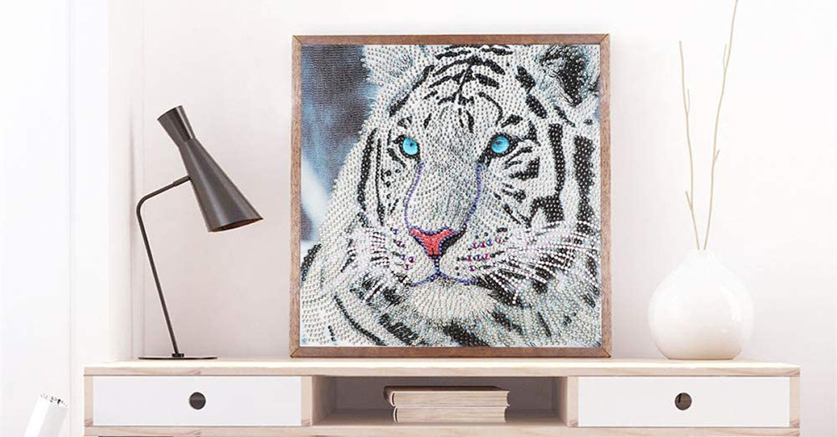 Framed diamond painting of tiger on a sideboard