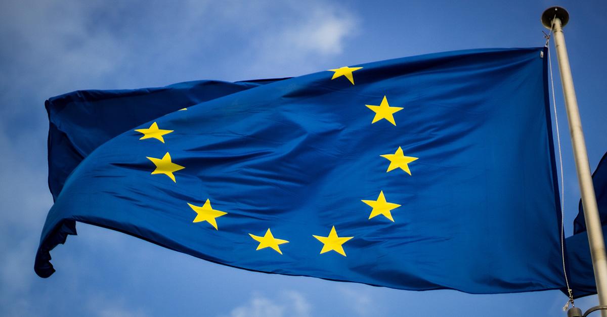 Blue European Union flag flying on a flagpole