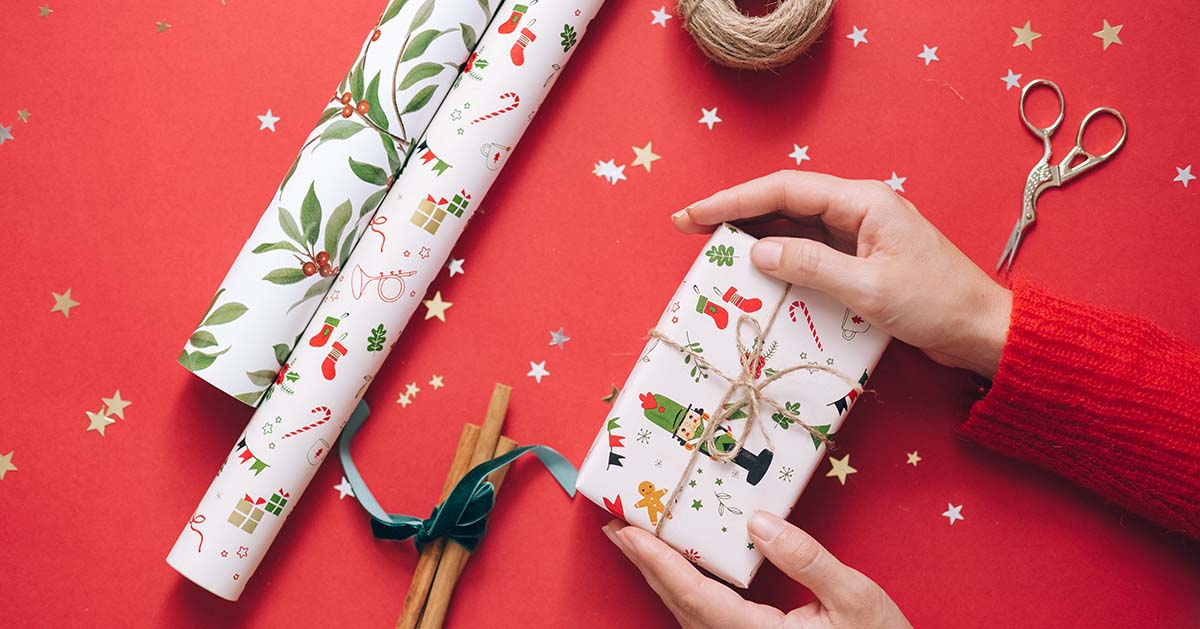 Women wrapping holiday gifts