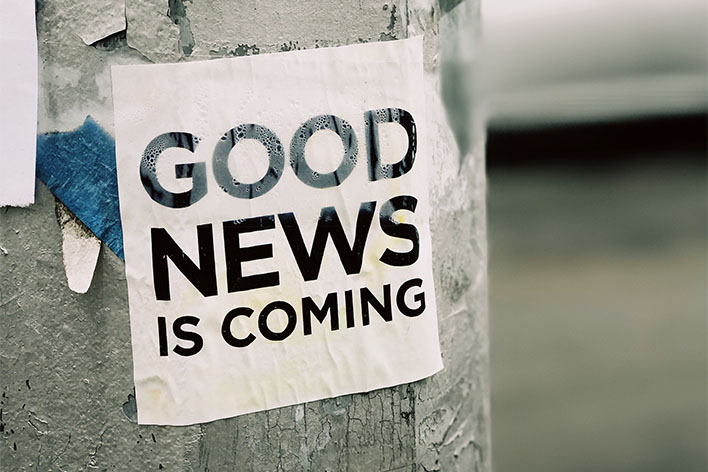 "Sign saying ""Good news is coming"""
