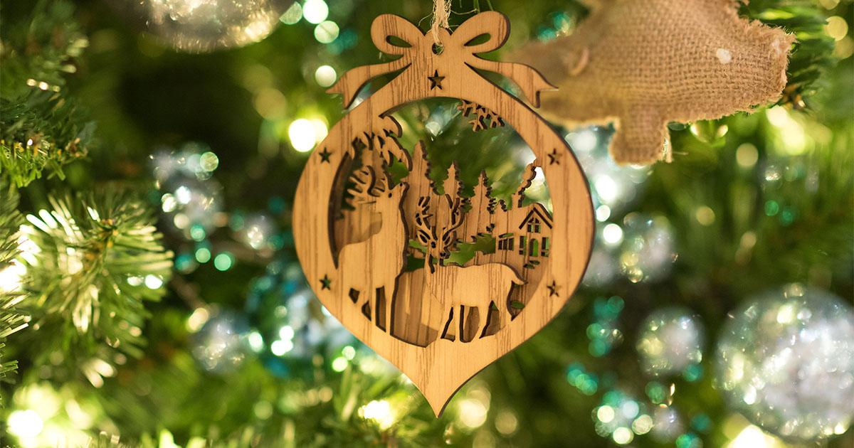 Handmade wooden reindeer ornament hanging in Christmas tree