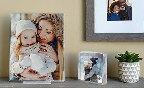 Woman holding baby are among the exquisitely printed glass, acrylic, and custom framed products displayed in warm home