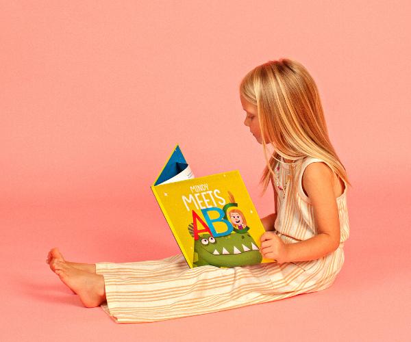 NAMEE Alphabet book - Mindy reading ABC book.png