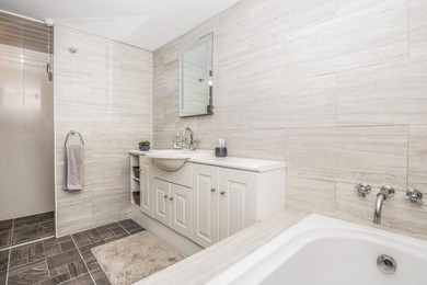 Spacious main bathroom with bath