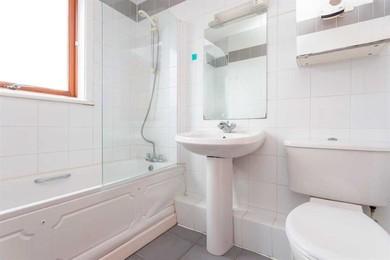 Bathroom with wall tiled