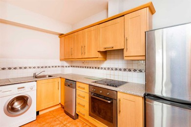 Reformed wood kitchen with wall tiled