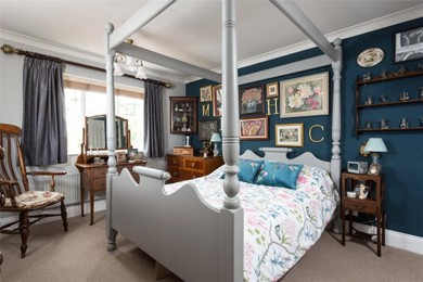 Bedroom with parquet and blue wall
