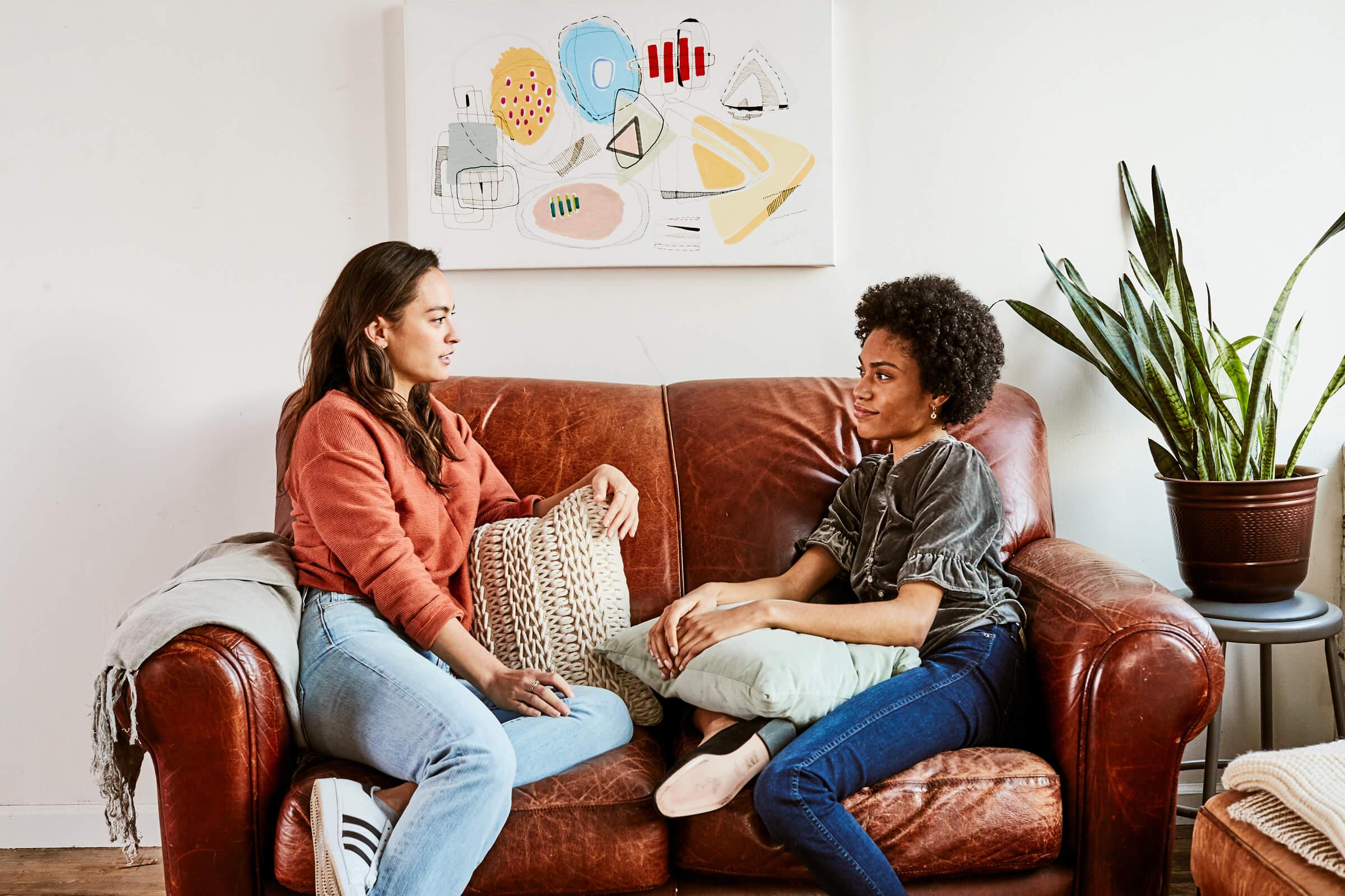 Two women talking on the sofa