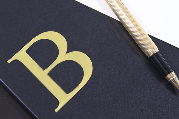 debossed initials
