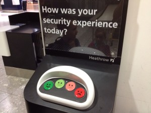 Photo of an airport security tracking customer happiness.