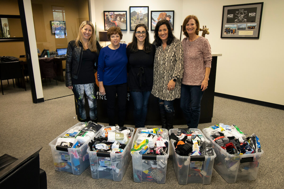 Nextiva donated more than a thousand pairs of socks to K2 Adventures Foundation.