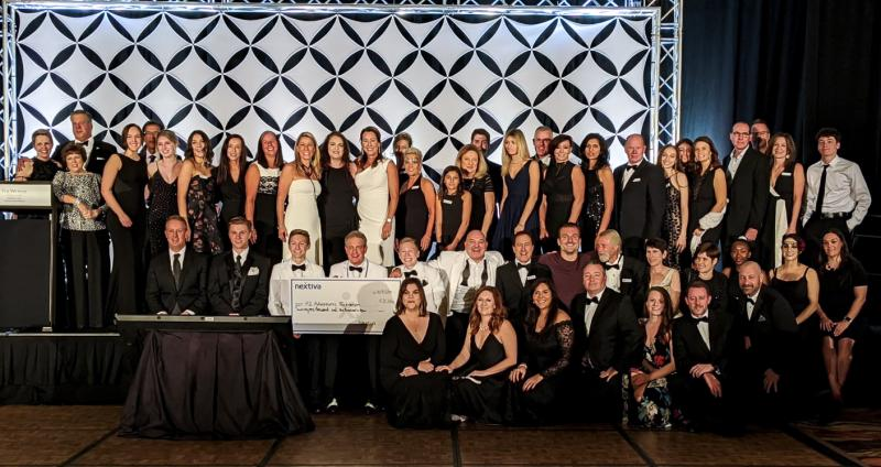 Nextiva Delivers a Huge Check to K2 Adventures Foundation Annual Gala