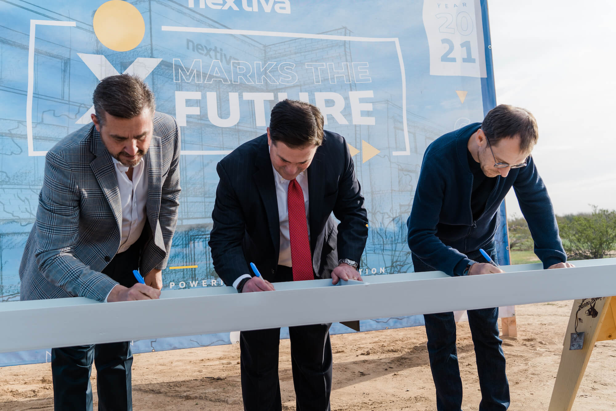 Nextiva Co-Founders and Governor Doug Ducey Sign Iron Beam for New Office in Scottsdale