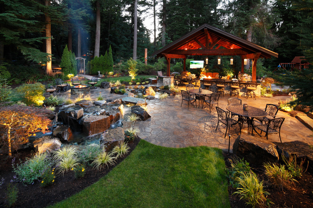 outdoor resort and living space with water feature