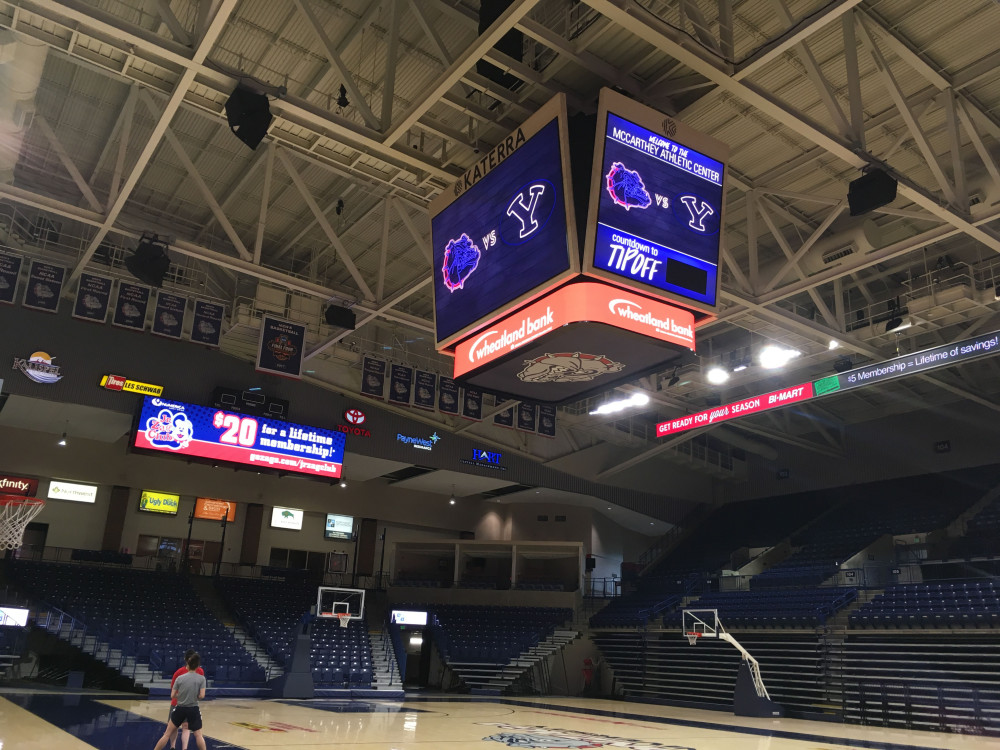 over head scoreboard and wall signs
