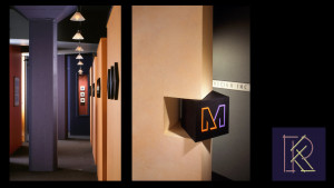 Studio for a graphic design company used color and lighting to create a custom space on a shoestring budget.